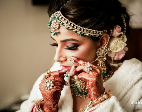 NOSERING-SHOT-BRIDE-GETTING-READY-BATHROB-NISHURAJ-RESORTS-WEDDING